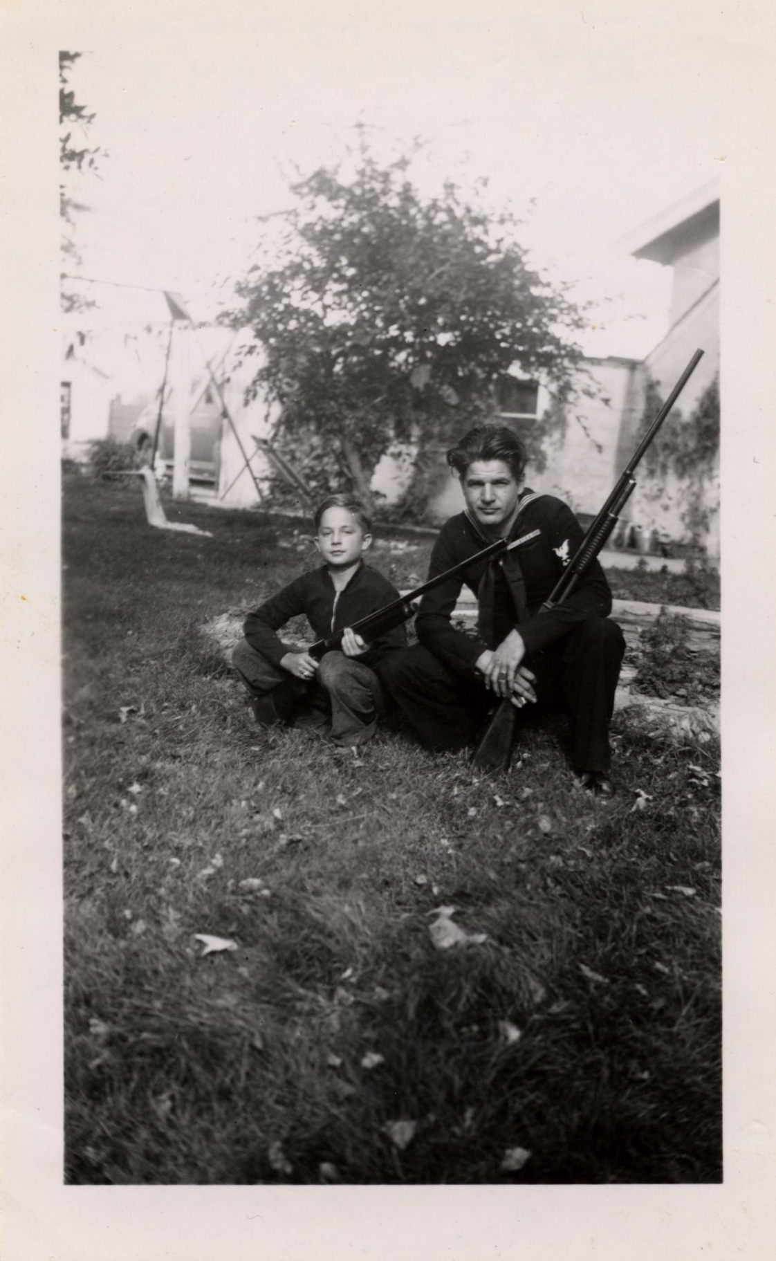 Leon Inar Morrison (26) and Ivan Peterson Jr. (almost 10) (front) (circa 1943)