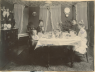 Portrait of Henry and Millie Fritz's family at the dinner table.